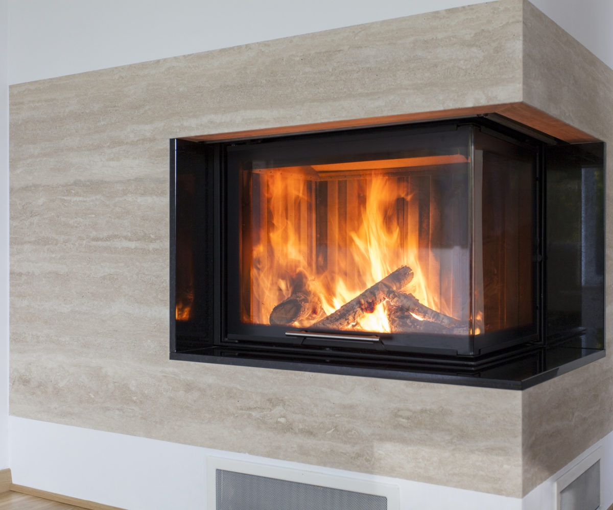 Closeup of fireplace made with a travertine
